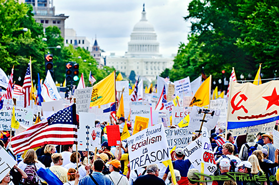 The Tea Party crowd marches down Pennsylvania Avenue to the Capitol.