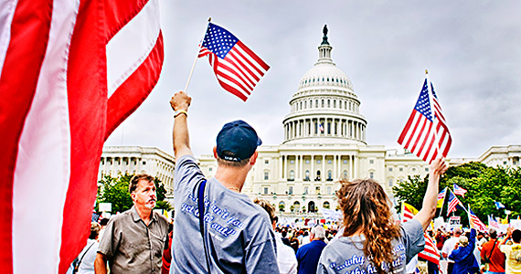 Americans gathered by the thousands in Washington, D.C. to attend the 9/12/09 Tea Party on the Capitol lawn in protest of big bailouts, corruption and overreaching federal control of health care.