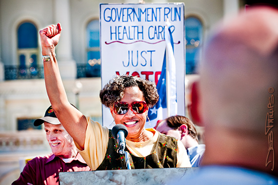 "A black woman speaks to the crowd at the ""Kill the Bill"" rally outside the U.S. Capitol on 3/20/10."