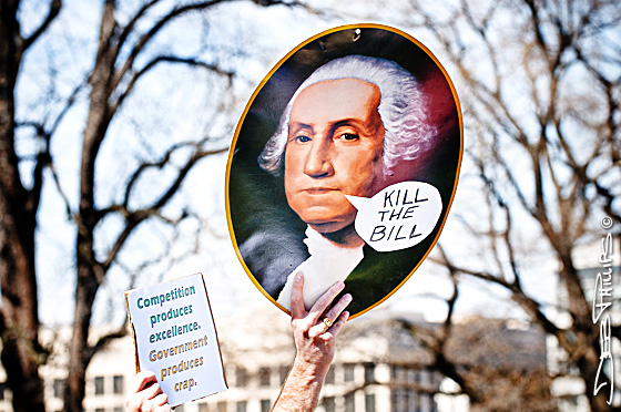 "A sign showing George Washington saying, ""Kill the Bill."""