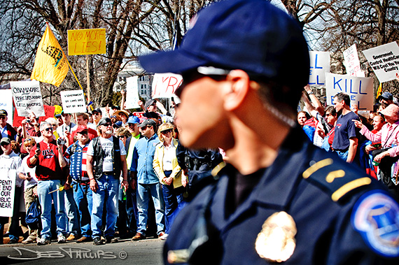 A Capitol Hill policeman engaged in crowd control at the 3-20-10 Washington, DC Kill the Bill Rally