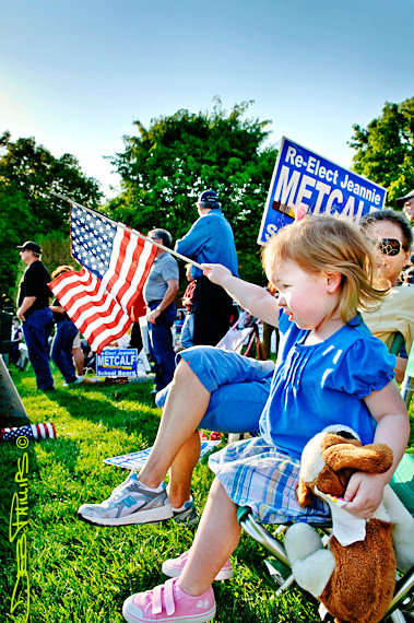 A little girls wave a flag at the 4/15/10 Winston-Salem Tax Day Tea Party.