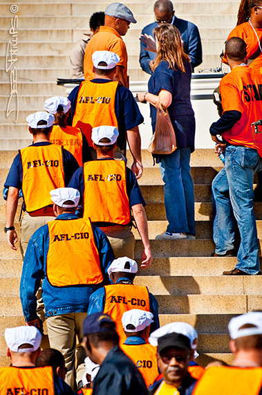 AFL-CIO labor union members walk up the steps of the Lincoln Memorial
