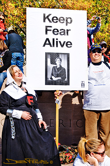 Rally to Restore Sanity and/or Fear attendees hold sign about Sarah Palin.