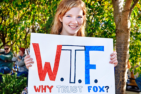 Young girl holds sign about Fox News at the Rally to Restore Sanity and/or Fear in Washington, D.C.