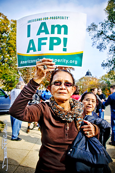 "Woman holding up ""I Am AFP!"" sign at the November Speaks Rally on November 15, 2010"