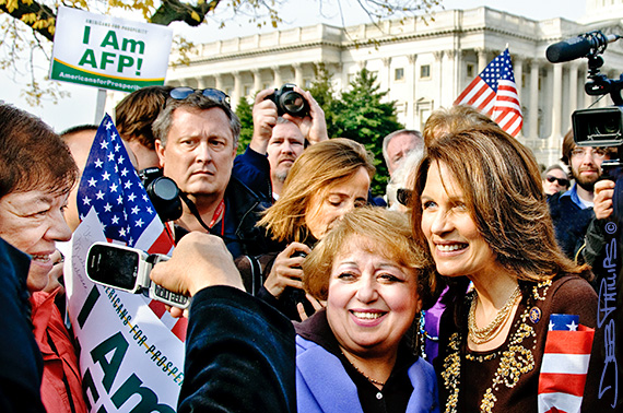 Michele Bachmann poses with a woman in the crowd.