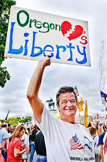 Man holding Oregon sign