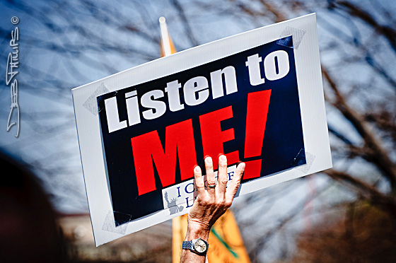 "A sign, ""Listen to Me!"" is raised by a protester at a Tea Party rally in Washington, D.C. on Saturday, March 20, 2010."