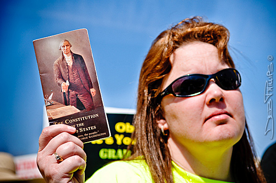 A woman holds up a copy of the U.S. Constitution at the health-care protest rally.