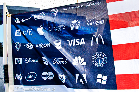 US flag with corporate logos in place of the stars