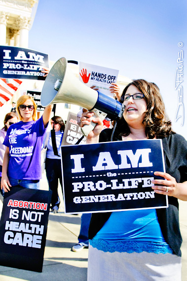 ObamaCare protesters and supporters gathered outside the U.S. Supreme Court, Washington, DC during oral arguments on March 27, 2012.